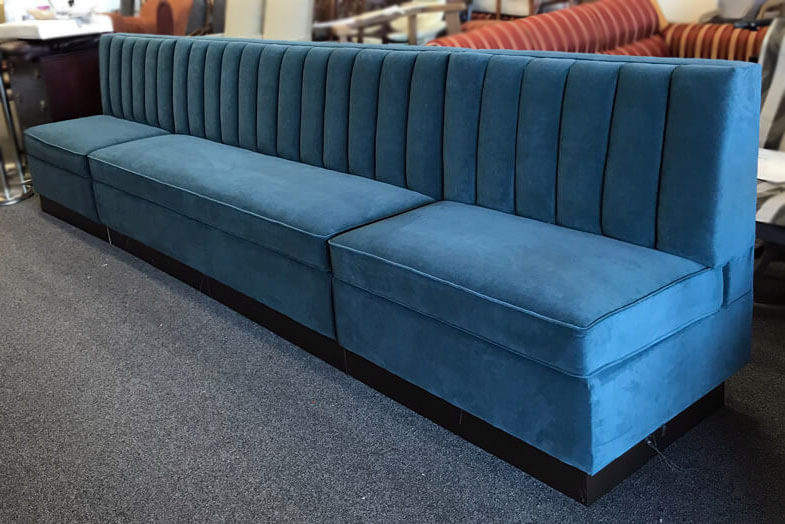 Custom made blue seatbench with fabric upholstery