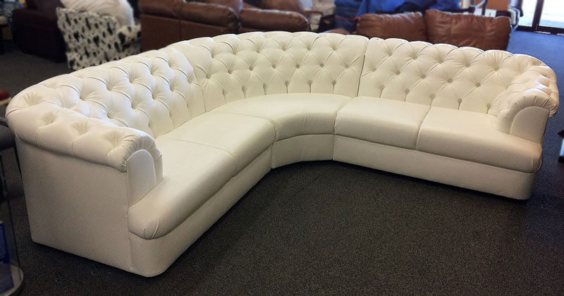 Custom made sectional with tufted back and leather upholstery