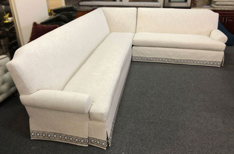 One corner sectional custom made and reupholstered with fabric