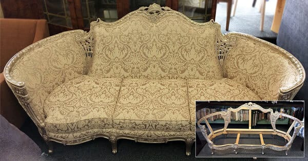 Antique sofa repaired and reupholstered with golden textured fabric