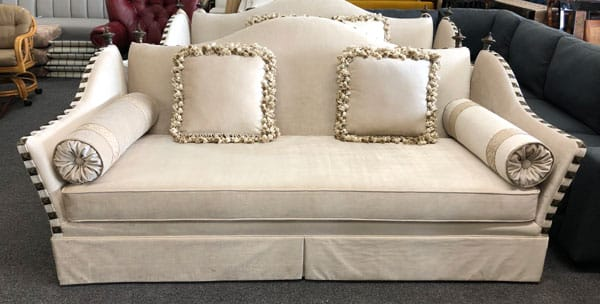 Loveseat reupholstered with through pillows