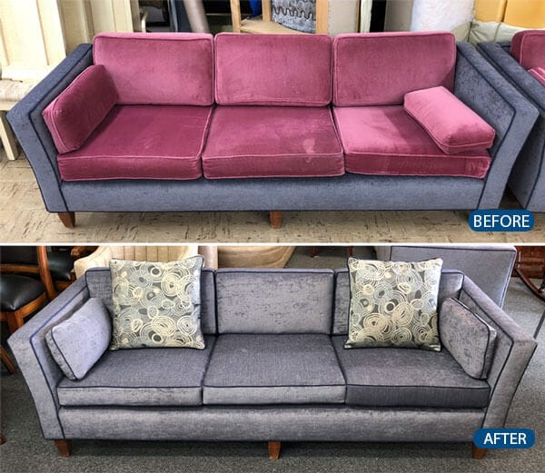 Sofa reupholstered with grey fabric and two custom throw pillows