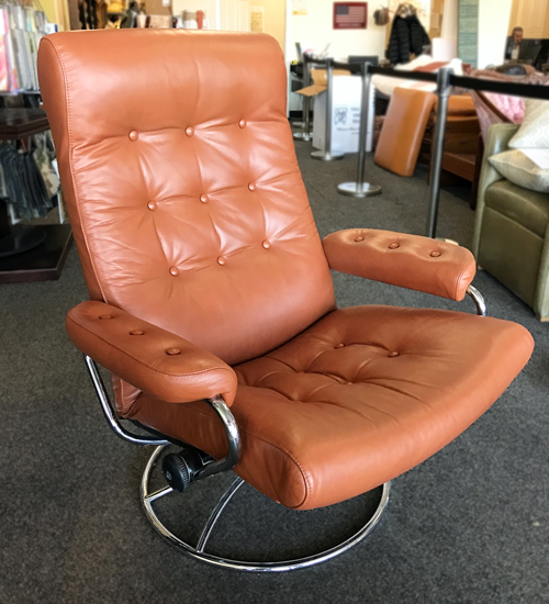 This model converts from chair to recliner and upholstered with leather of color that easily fits the most interiors.